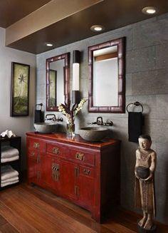 Red Chinese sideboard repurposed as bathroom vanity cabinet