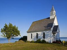 Chapel of Port-au-Persil, Quebec, Canada ~ The Chapel of Port-au-Persil is perched on the shore of the Saint Lawrence River. Charlevoix Quebec, Saint Lawrence River, National Geographic Travel, Destinations, Vacation Trips, Vacations, Canada Eh, Quebec City, Culture Travel