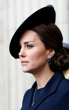 The Duchess of Cambridge wearing pear-shaped tanzanite and diamond pendant and earrings by the Queen's personal jeweller, G Collins & Sons, at a commemoration service for troops who were stationed in Afghanistan in 2015