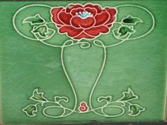 This beautiful Art Nouveau rose features in a fireplace surround in a dining room. The fireplace surround dates circa 1908.