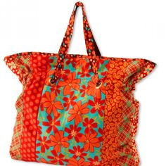 Pull-up straps and a roomy interior make for an easy-to-piece tote bag.  Fabrics are Petalicious prints by Nancy Thias for Marcus Fabrics [1].   [1] http://www.marcusfabrics.com