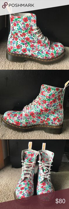 Poppy floral air ware doc martens leather Excellent used condition! Only worn a couple of times. Leather poppy floral upper, rubber sole. Only real signs of wear is that they are broken in ( a little bit of creasing-pictured), and there is a little bit of discoloration on top inside of boots. This print is very unique, especially in white! So comfortable and cool. doc martens  Shoes Lace Up Boots