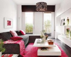 Chic Apartment Living Room Interior Design With White Wall Paint Color And Cool Two Level Coffee Table In White And Pink Floral Rug Also Brown Corduroy Sofa Bed With Pink Floral Pillows And White Wall Cabinets Small Living Room Design, Small Apartment Living, Small Apartment Decorating, Small Living Rooms, Decorating Small Spaces, Living Room Modern, Apartment Design, Interior Design Living Room, Living Room Designs