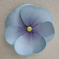How to make pansies with butterfly punch   http://www.youtube.com/watch?v=p_WOXyF7SpY: