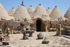 These are beehive homes in Harran, Turkey near the border with Syria. Beehive homes stay cool in the desert heat. Their thick mud brick (adobe) walls trap in the cool and keep the sun out as well. More at www.naturalhomes.org/beehive-harran-turkey.htm