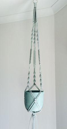 Silver macrame hanger by the planter pod.