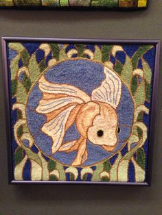 """""""Stained Glass Fish"""" Hooked by, D. Marie Bresch  Designed by, Jane McGown Flynn"""