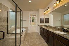 Oak Forest Home Ready For Move-In - 3,386 Sq. Ft. - Master Bathroom - #PerryHomes #trustedbuilder #OakForest #HoustonHeights #TheHeights #HoustonHomes #realestate #relocatingtohouston #houstonenergycorridor #openconcept #openfloorplan #interiordesign #homebuilding #homebuying #summersalesevent #masterbathroom #masterbath #masterretreat #gardentub #showerseating #tilefloor #vanities #twosinks