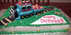 Made for a special friends little man's 2nd birthday! Thomas the train is resting on a chocolate cake frosted in buttercream. He is all edible and filled with delicious jelly beans! Made by Sweet for the Soul in Pensacola.