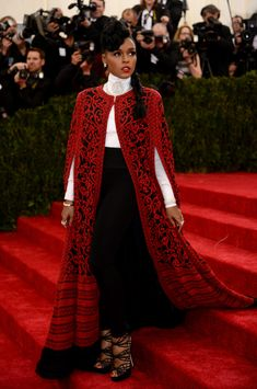 BEST: Janelle Monae in Tadashi Shoji  Monae habitually sports a self-described uniform of black and white, and this glorious, bold Shoji cape was an elegant way to take that uniform and kick it up a notch. All credit to her that she managed to honor the Met Gala's Charles James theme while staying true to her modern, cool aesthetic.