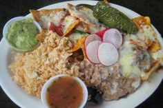 MEXICO: Depending on the region of Mexico, typical breakfast items may vary slightly, but often include ingredients such as corn tortillas, eggs, beans, and sauces, compiled in different way. One common breakfast item is chilaquiles — fried corn tortilla chips topped with green or red salsa (or mole), cheese, and refried beans, sometimes with eggs and/or pulled chicken mixed in.