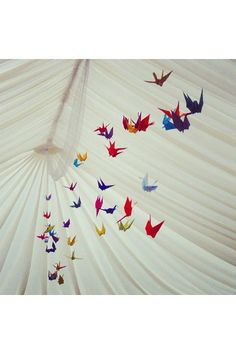 Birds of a feather flock together: origami birds will add a creative pop of colour to your ceilings.