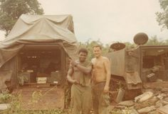 Two soldiers of the 11th ACR with M113 APCs behind them