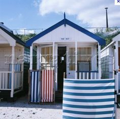 the typical British beach; wind breakers, deck chairs and beach hut - coordinating colours of course!