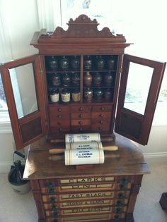 This little apothecary was from a druggist in Indianapolis and it dates to 1875. Note the drawers on the top cabinet, and the notions drawers on the bottom.
