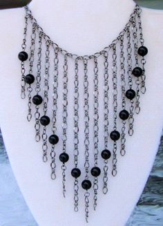 Black Pearl & Gunmetal Chain Necklace  $89.00   Sexy gunmetal chains and black pearls give this trendy chain necklace an elegant look