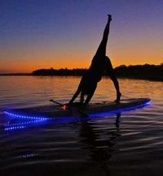 Wow. Paddle Board Yoga. Now...I'm no yogi (sp?), but how damn cool is this!?!