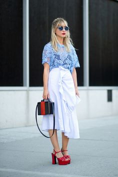 Kerry Pieri in Westward Leaning sunglasses, a JW Anderson skirt and Saint Laurent shoes