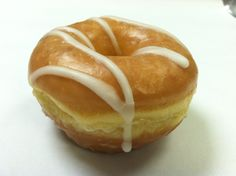 I've been Glazed and Confused - for so long it's not true!  Even Led Zeppelin would love this simpleton donut with a crazy vanilla drizzle twist!  Copyright Psycho Donuts, All Rights Reserved.