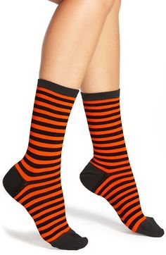 Show a little Halloween spirit in these orange and black striped socks.