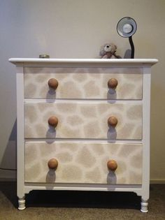 Set of Drawers I renovated this very old and worn set of drawers for the nursery. Originally all timber (with stains all over it!). After much sanding, I added a cute giraffe print and painted the shell a crisp white. This turned out to be the perfect addition to the nursey without being too babyish.