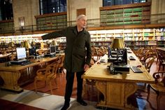Koolhas points to the desk at the NYPL where he wrote Delirious New York