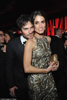 Relationship goals: Ian rested his head on his wife's bare shoulder for a sweet photo inside the soiree