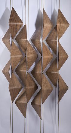 Walnut Window Shades - The shades hide and reveal what is behind through a simple rotation  of each bar. When situated in front of a window they register different  patterns of light throughout the day. When situated in the center of a  space, they can both divide and connect depending on the angle of rotation.