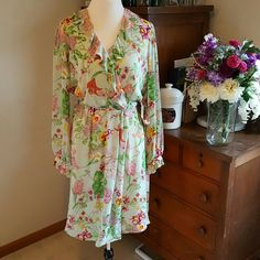 Austin Reed Gorgeous vintage look wrap dress in mint with a delicate floral pattern in pink, fuscia, and yellow. Ruffles at neckline and cuffs. Perfect drape and 100% silk. Runs a little large. New with tags, never worn. austin reed Dresses