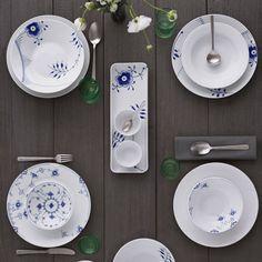 Kay Bojesen Grand Prix dinner fork, dinner knife, and dinner spoon. Royal Copenhagen plates. Kay Bojesen Grand Prix cutlery/flatware. Danish Design.