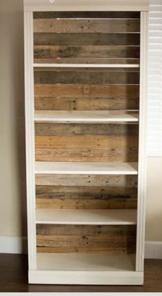 Replace the cardboard backing on inexpensive bookshelves with slats from pallets for an interesting look and more stability.