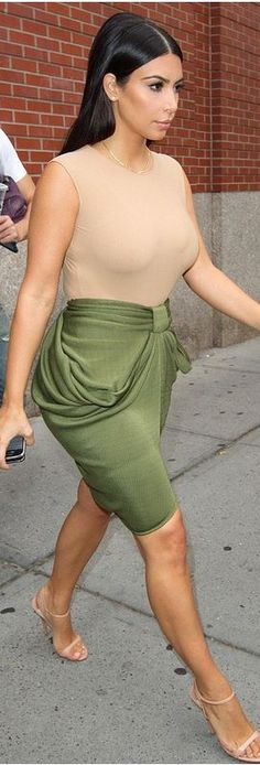 Kim Kardashian: Skirt – Balmain  Shoes – Prada  Shirt – Maison Martin Margiela