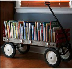 Wagon as Bookshelf –An adorably clever way to display and organize your (kids) books or movies