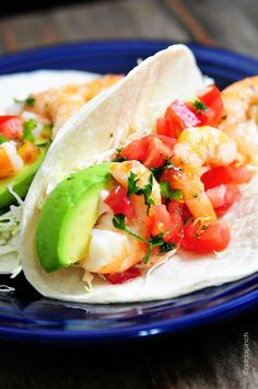 Shrimp Tacos make a delicious, quick and easy lunch or dinner. Layered with flavor, this shrimp tacos recipe is a definite favorite. Shrimp Taco Recipes, Shrimp Tacos, Fish Recipes, Mexican Food Recipes, Dinner Recipes, Shrimp Avocado, Recipies, Avocado Salad, Dinner Ideas