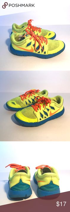 Nike Free 5.0 Sneakers Running Shoes(bad lighting) Good Condition. Forgive my lighting. Shoes are not dirty on front netting. Nike Free 5.0 Sneakers Running Shoes. Preowned. Bright yellow, blue and orange accents/laces. Still lots of life left! Nike Shoes Sneakers