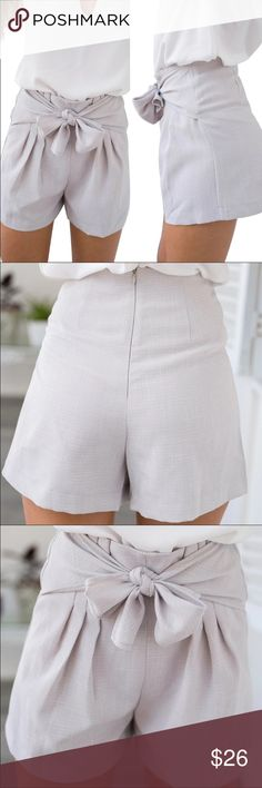 New high waist bow shorts New in package condition. High waist shorts. Bow tie at front. Zipper closure at back Shorts Jean Shorts