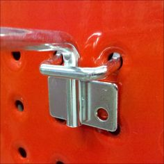Hybrid Design Metal Hook on Red Perforated Metal Display Surface Hybrid Design, Perforated Metal, Hooks, Door Handles, Retail, Design Inspiration, Surface, Display, Google Search