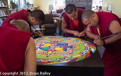 Sand Mandala being made by the Tibetian Buddist monks of the Drepung Loseling Phukhang Monastery.  I've seen them several times when they visited Virginia and it is something amazing.  This site has some great pics and interesting info.
