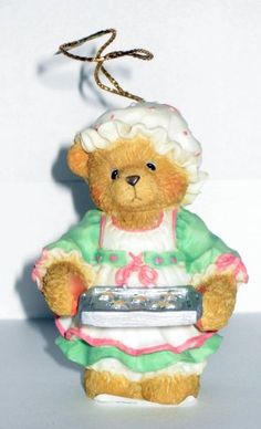 Cherished Teddies Girl Holding Tray of Cookies Hanging Ornament by Cherished Teddies, http://www.amazon.com/dp/B001FX3U3U/ref=cm_sw_r_pi_dp_ZJbXqb10VY279