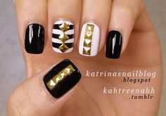 Black and white nail polish with gold studs. I love triangle studded nail arts!