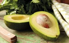 Cutting Calories Photographic Print: Ripe Avocado Cut in Half on a Wooden Table by Olga Krig : High Protein Vegetables, High Potassium Foods, Type 2 Diabetes Diet, Plant Sterols, 100 Calorie Snacks, Avocado Health Benefits, Bulletproof Diet, Hair Loss Cure, Nutrition