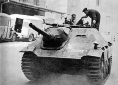 [Photo] Polish resistance fighters with a captured Jagdpanzer tank destroyer, Warsaw Uprising, Poland, 14 Aug 1944