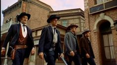 """Three Earps & Doc Holliday walking down the street on the way to the """"Gunfight at the O.K. Corral"""""""