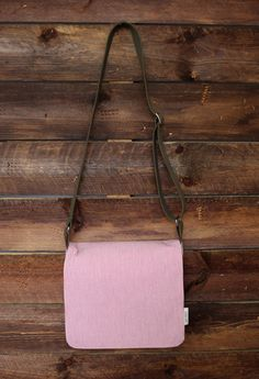 pink/white striped seersucker messenger bag with black strap | The Renew Project provided employment and community for Refugee women