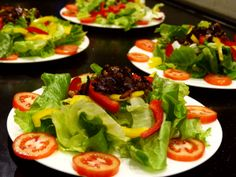 Starter - fresh leaf lettuce with sautéed bacon pieces and pumpkin seeds