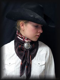 Nevada Watt - This very talented young lady makes gorgeous silk wild rags, silver jewelry, and slides like the one in this pic.  Via Ranch2Arena