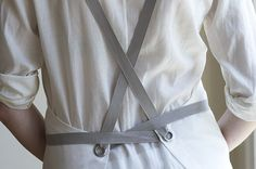 The cross back kitchen apron adjusts for a comfortable fit