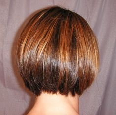 Warm golden caramel accents the darker brunette base. A bit stronger and piecier to add visual interest to a classic bob.