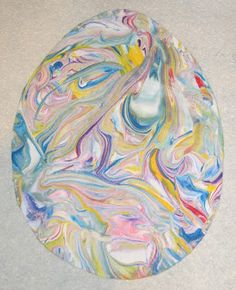 Create marbled eggs with shaving cream! - Can be done with any cutout shape... leaves, hearts, whatever!