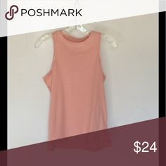 """High Neck Tank Pink high neck tank. The modern cut features slightly dropped arm holes, a high crew neck, and slightly cropped, A-line shape. Large measures Bust 18"""" Length 23-24"""" rayon poly blend Billabong Tops Tank Tops"""